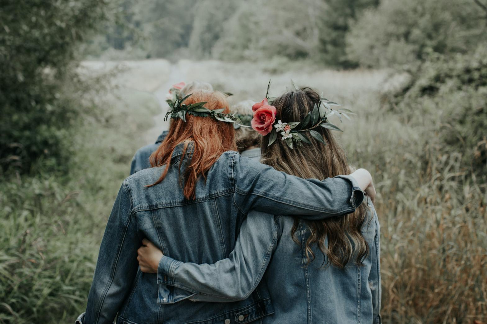 Women walking together with flowers in their hair