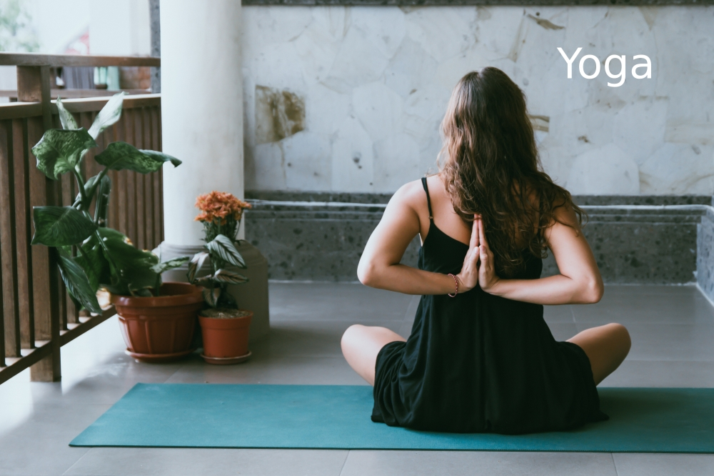 Yoga link, showing a woman sitting in a yoga pose.