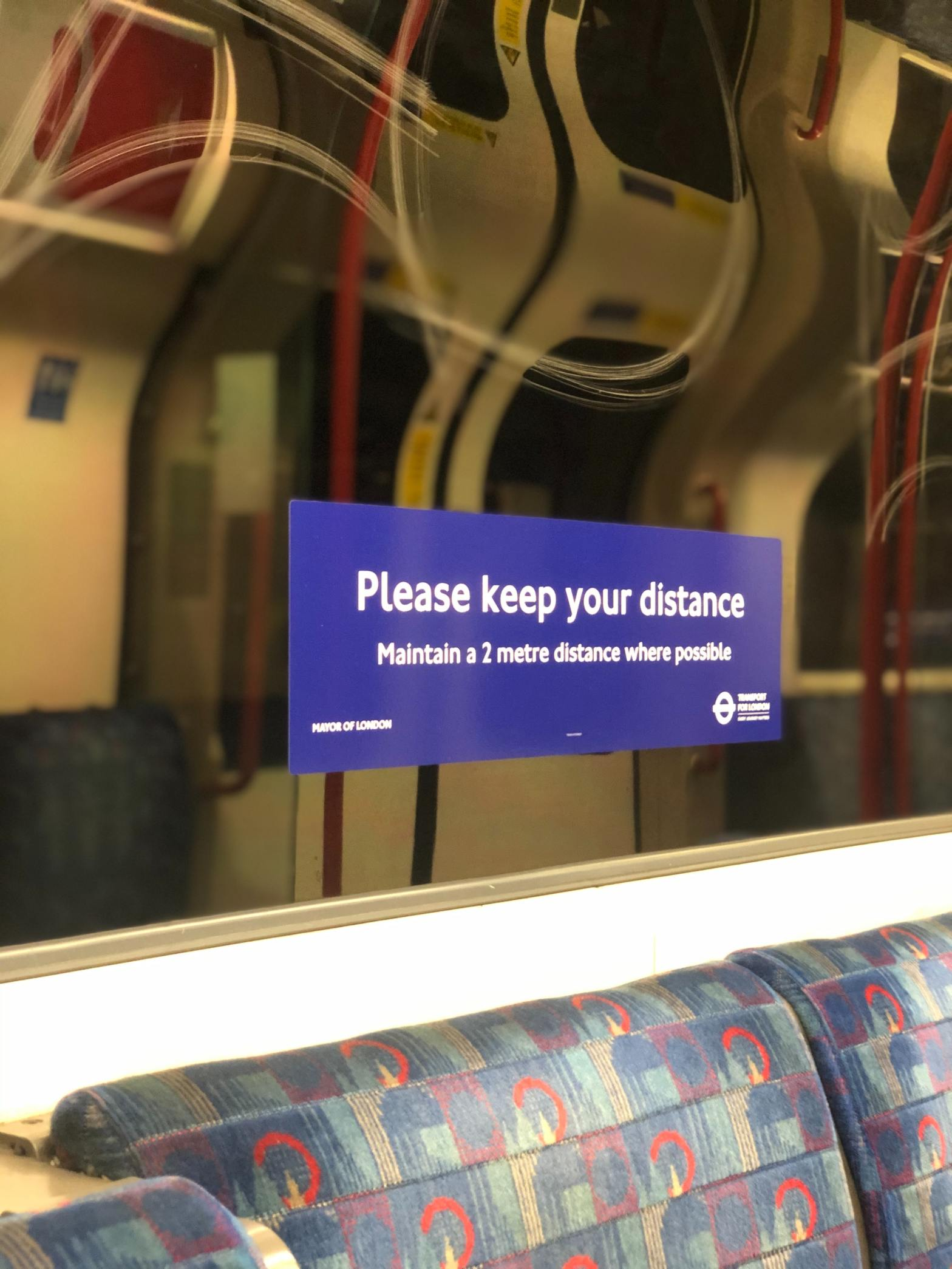 Social distancing sign on a tube train