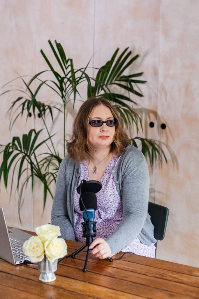Charlotte recording a podcast.